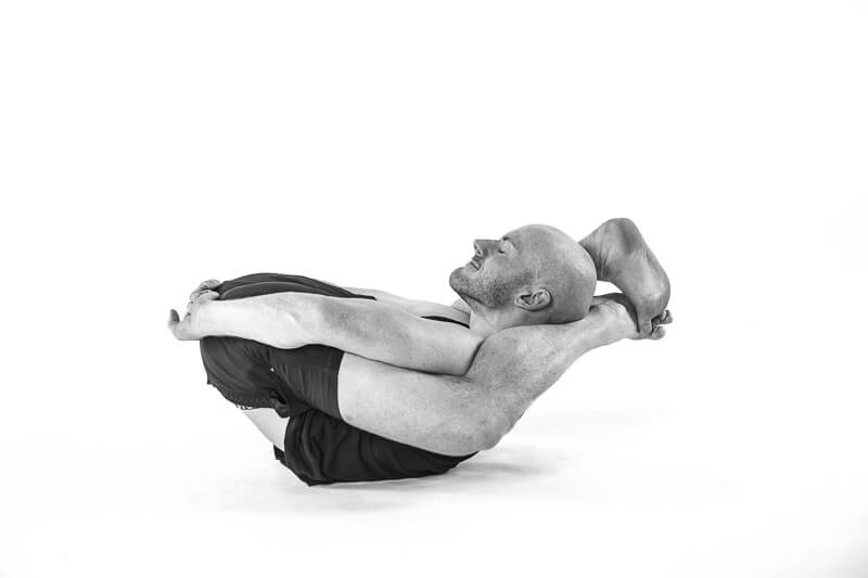 relaxing yoga with legs over the head. Also in the advanced series of bikram yoga